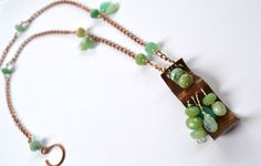 beautiful and rustic green/blue faceted Peruvian opal copper/silver beaded necklace with large hammered rustic pendant. $69.00, via Etsy.