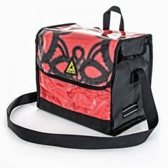 'Dutchy' Recycled Billboard Bike Pannier- Great when you have some extra baggage you want to tote around town. Fits snug on your bike and each one is unique so you won't get confused. Great gift idea!