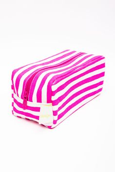 This shape of cosmetic bag is PERFECT when packing for a trip.  They seem to fit perfectly along side a stack of folded clothes, or on its end too.  Plus, this is a huge bag, so you can fit all your cosmetics in it.  Love the pink and white stripes!