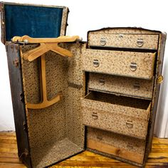 1920s metal steamer trunk wardrobe // essentially a mobile closet. Replete with drawers and a hanging section, this one's perfect for the extravagant traveler—or the at-home minimalist -- I wish someone would bring these back! #designinspiration