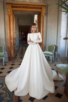 Milla Nova Josephine borrows from Meghan Markle signature minimalist elegance #weddingdresses
