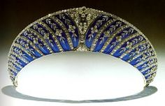 Blue Enamel Kokoshnik ~ The Westminsters have this intriguing tiara from Chaumet. A kokoshnik is often used to refer to a tiara that takes the shape of the traditional fabric Russian headdresses. This one, however, is an unusually literal translation in which blue enamel serves to mimic the fabric kokoshniks were made of and diamond flowers translate to the ornamentation kokoshniks often featured. This one was originally bought by the 2nd Duke of Westminster.