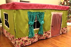 Tablecloth playhouse! Fits over table for compact storage:) ~~ Too adorable! I can make something like this to fit over Julie's play table to make it into a play house!