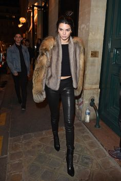 Kendall Jenner wearing Balenciaga Leather Leggings, Saint Laurent Cassandre Tassel Bag, Sally Lapointe Mink Fur with Cross Fox Fur Panel Jacket, Balmain Nina Leather Ranger Booties