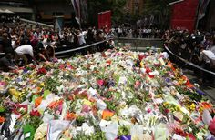 The siege of a cafe in the Australian city of Sydney has ended and many people have come to the scene of the siege to place flowers. Sydney Cafe, Australia Country, Facial Masks, New Zealand, Dolores Park, Scene, City, World, Places