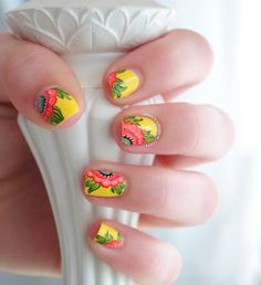 Bright detailed floral nail art on sunny nails!