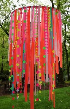 Tie ribbons to a hula hoop and hang from the ceiling of your reading area.