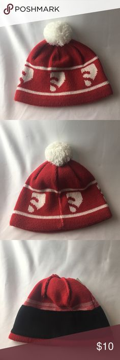 Red and white Solomon pom-pom hat Red and white Solomon pom-pom hat with black fleece lining. Extremely warm! Never before worn Solomon Accessories Hats