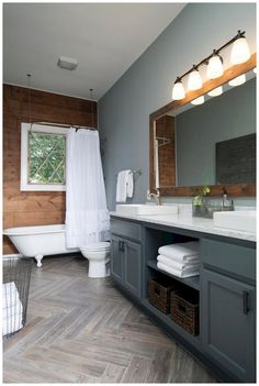 Need to update your bathroom? Check out these twenty one-of-a-kind beautiful farmhouse bathrooms that, we have to admit, we're totally obsessed with.  #ModernFarmhouseInteriors #ModernFarmhouseBathroom #RusticFarmhouse #FarmhouseStairs #ModernFarmhousePlans #FarmhouseIdeas #FarmhouseDesign #BathroomRenos #BathroomInterior New Bathroom Ideas, Bathroom Tile Designs, Bathroom Floor Tiles, Tile Floor, Bathroom Mirrors, Floor Mirror, Bathroom Updates, Bathroom Inspo, Bathroom Layout