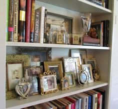layering family photos on a bookshelf<3