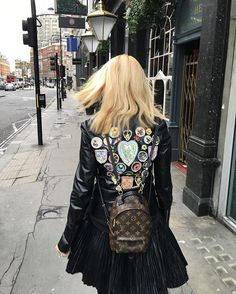 Yana Rudkovskaya in Chanel jacket, YSL skirt and Louis Vuitton backpack.