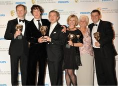 """""""If you didn't know who these people were, and I asked you to guess which two were married to each other, I'll bet you any money you'd guess the wrong two. Benedict is holding Martin. Martin is holding Benedict. They are holding the trophy together. Their fingers are touching. And Benedict is wearing a full velvet suit. VELVET."""