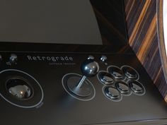 Retrograde from surface tension. Upright arcade gaming using modern design, materials and technology. MAME-compatible with genuine arcade controls.