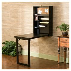 Franklin Writing Desk - this folds up into a rectangular box that hangs on your wall. Brilliant.