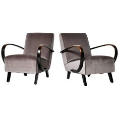 Pair of Jindrich Halabala C-Shape Lounge Chairs | From a unique collection of antique and modern armchairs at https://www.1stdibs.com/furniture/seating/armchairs/