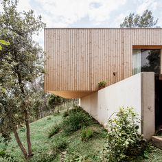 Cantilevered timber house overlooking mountains near Barcelona by Alventosa Morell Arquitectes