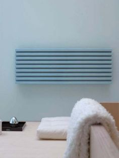 Pop horizontal radiator: a high quality and energy efficient aluminium radiator, manufactured in Italy. It combines the benefits of aluminium with modern style: trendy appearance as well as po Bedroom Radiators, Radiators Uk, Decorative Radiators, Horizontal Radiators, Radiator Heater, Interior Styling, Interior Design, Aluminum Radiator, Futuristic Design