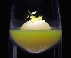 Alinea restaurant in Chicago, IL - this particular experience is a shot of celery juice with basically a delicate ball of white chocolate (it's a little more complex than that) containing apple juice that bursts in your mouth, topped with celery leaves.  25th birthday trip, anyone?