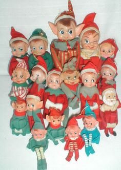 A wondrous assortment of vintage Christmas Elves, with one Santa to keep them in line.