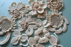 Set of motifs consists of 7 parts, linked from cotton yarn of different colors. This Motif can be used as an Irish lace, appliques in the garment,