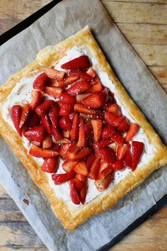 A crisp and buttery galette topped with light mascarpone cream, and strawberries drizzled in sweet balsamic vinegar and ground black