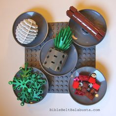 The LEGO minifigs are jealous.  This time, we've made a seder plate sized for the big people. TWO VERSIONS: The Six-Holer (above), for the kosher sticklers. Includes the second bitter herb, Chazere...