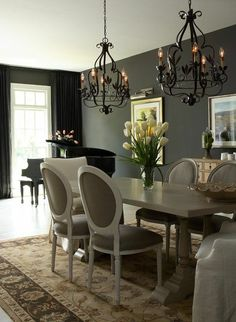 Gold Beige and Gray Brown Carpet. Gray brown Chairs. Those chandeliers are RAD!!