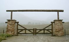 Beautiful gate with stacked stone - refresheddesigns.sustainable design