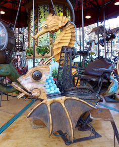 Fish and seahorse on the very steampunk carousel in Brussels, Belgium.
