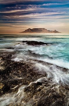 A pathway of foam points the direction to Table Mountain in the Western Cape of South Africa.  John & Tina Reid  |  Commercial Portfolio   |  Photography Blog   |  Travel Flickr Group