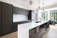 The steel framed windows and doors were designed with a black finish to accentuate the dark tones used within the interior design. Open Plan Kitchen Living Room, New Kitchen, Kitchen Ideas, House Extension Plans, Extension Designs, Home Kitchens, Modern Kitchens, Industrial House, Internal Doors