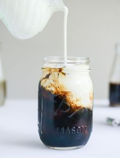 Cold brew coffee with homemade vanilla bean, blackberry, almond and cinnamon-brown sugar syrup! via - howsweeteats.com