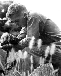 A young Marine finds a moment of quiet and solitude in which to offer up a prayer for the safety of himself and his comrades. Minutes later, the 1st Marine Division launched an offensive against entrenched communist troops. Ca. 1951.