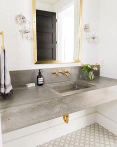 concrete countertop, gold mirror