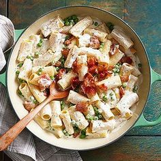 What could possibly be better than Alfredo-sauced pasta? Adding a little bacon and peas to the dish. Tip: Purchase ultra-pasteurized whipping cream. It will keep longer in the refrigerator than regular cream, allowing you to make this easy recipe often.