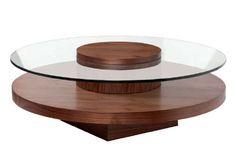 Mesa de centro redonda con cristal transparente. Acabado nogal