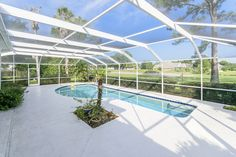 Dream house - 40' lap pool runs alongside the run up to the 5th green in Deerwood Country Club.  #deerwoodcountryclub  #gunillacraven #oakstreetrealty Pool house for sale in Jacksonville, FL.  Want it? I know I do.:)