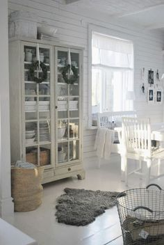 Gorgeous serene and calming colors in this farmhouse. The color n that hutch is so pretty