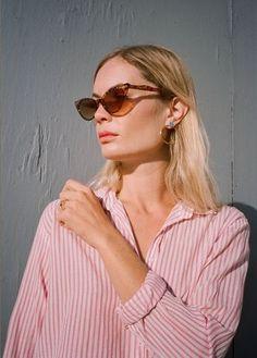Cat eye sunglasses, striped blouse