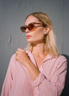 Cat eye sunglasses, striped blouse