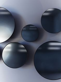 Castor: Black Mirrors, a black powder coated spun metal back gives the illusion of hovering off the wall