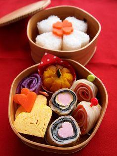 Love in a Bento Box by Warabi     (Heart-shaped onigiri rice balls and tamagoyaki omelet)