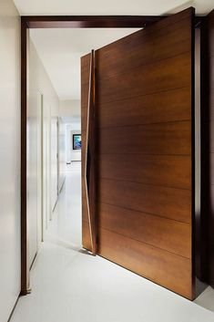 8 Breathtaking Single Front Door Designs (You'll Be Eager to Peek In) A collection of latest front door designs from modern houses. Offbeat ideas to design your wooden main /entrance doors with carved inlay from India, Bali & Sri lanka. Modern Entrance Door, Main Entrance Door Design, Modern Wooden Doors, Wooden Main Door Design, Entrance Doors, Home Door Design, Door Design Interior, House Front Design, Interior Doors