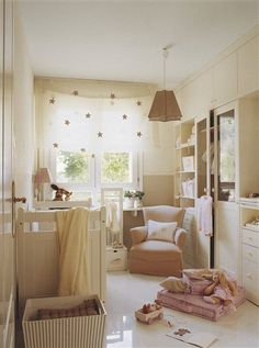 Adorable Nursery..love the window treatment with the polka dots, love the neutral color scheme, including the Built-ins, etc.....