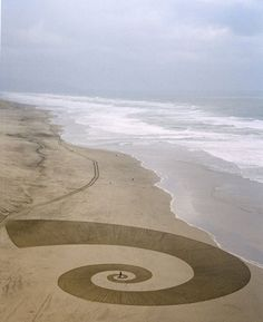 Andres Amador's Sand Art, well photographed sea just on the cusp of washing away pattern