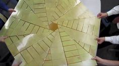Origami Solar Array Prototype. Researchers unfold a prototype of a solar array that uses origami principles for deployment. Brian Trease at ...