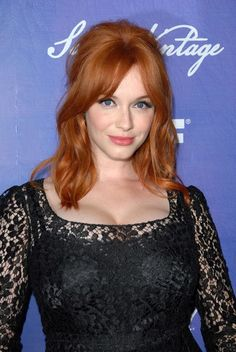 Get the Layered Bob with Side Swept Bangs | Vintage Red Hair Ideas by Makeup Tutorials at http://www.makeuptutorials.com/medium-haircuts-shoulder-length-hair