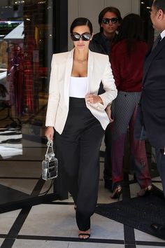 Get Kim Kardashian's fashionable take on tailoring for under $100. See how on Vogue.com.