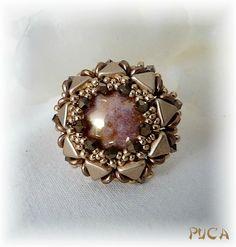 Puca -- pattern sold here: http://fr.dawanda.com/product/69784867-Schema-Bague-Cloz
