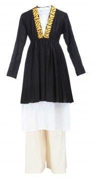 Kurta set with frill jacket by MASABA     Rs. 19,000